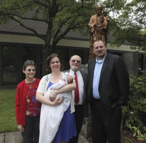 Abby with her godparents and parents